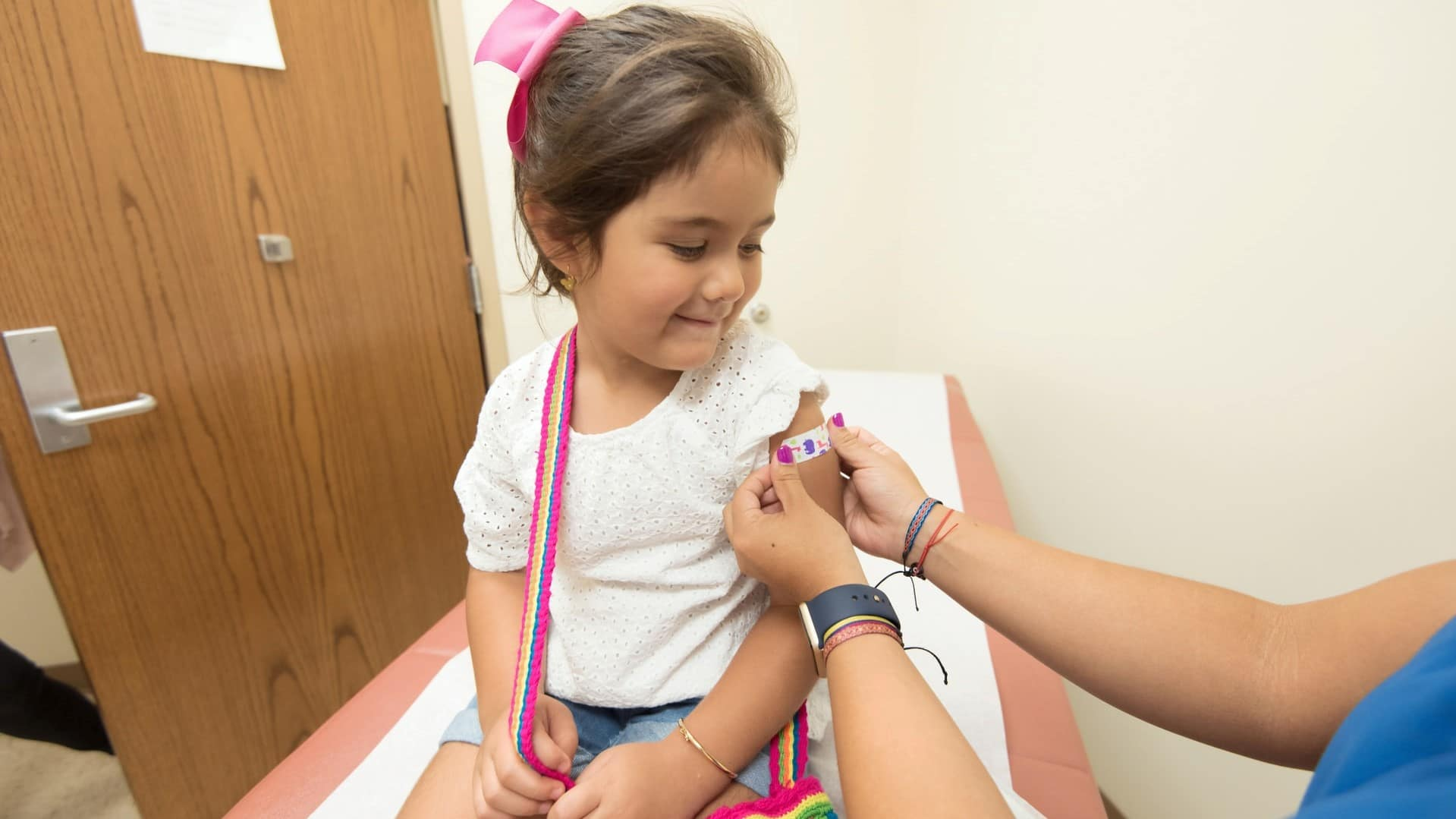 girl being vaccinated
